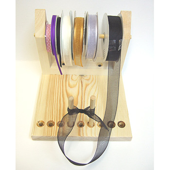 Ribbon Bow Maker http://www.craftracks.co.uk/bow-makers/bow-maker-with-ribbon-reel/prod_69.html